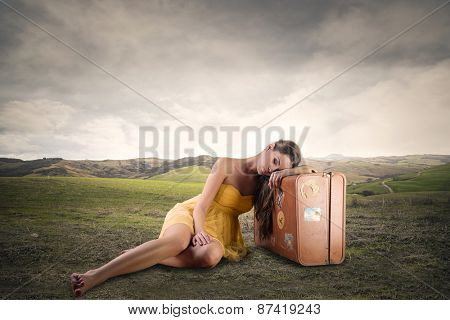 Girl sitting in a field