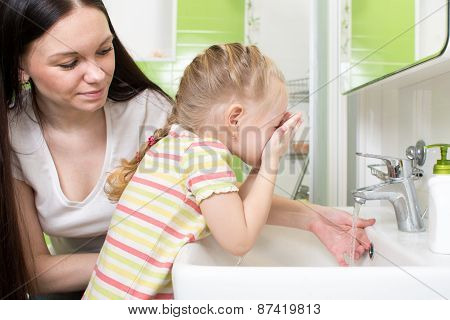 Cute Little Girl With Mom Washing In Bath