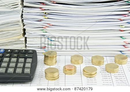 Pile Of Gold Coins With Calculator
