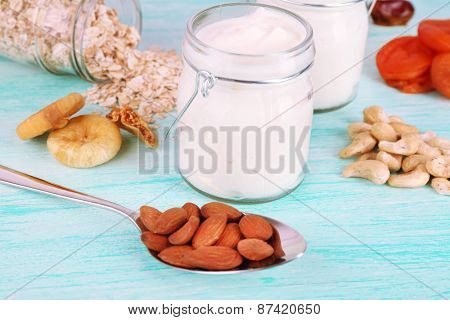 Healthy breakfast with dried fruits and nuts on color wooden background