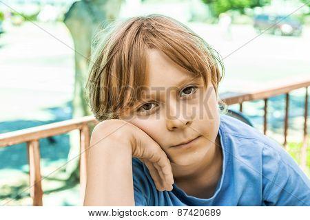 Boy With Brown Hair Looking Displeased