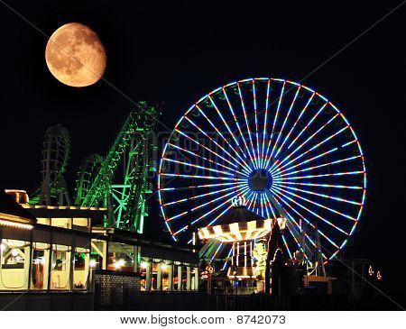 Carnival Rides with Orange Moon