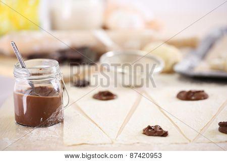 Making croissant cookies.