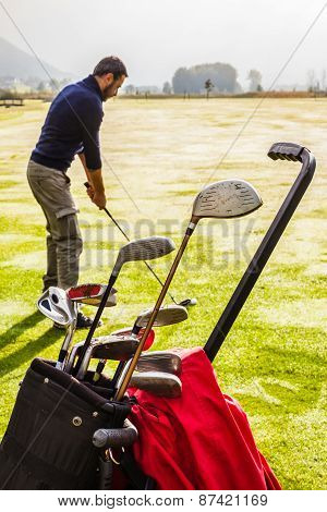 Golf Clubs And Golf Player