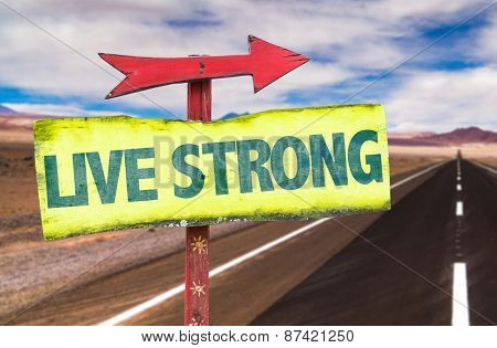 Live Strong sign with road background