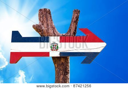 Dominican Republic Flag wooden sign with sky background