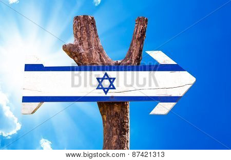 Israel Flag wooden sign with sky background
