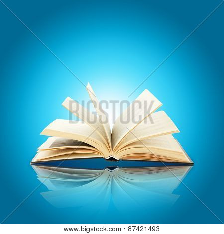 Opened book on bright blue background