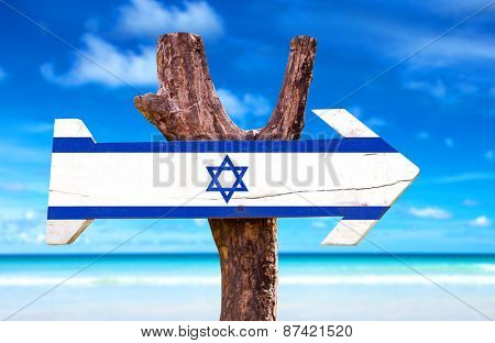 Israel Flag wooden sign with beach background