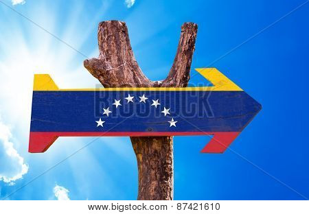 Venezuela Flag wooden sign with sky background