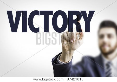 Business man pointing the text: Victory