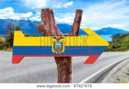 Ecuador Flag wooden sign with road background