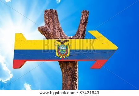 Ecuador Flag wooden sign with sky background