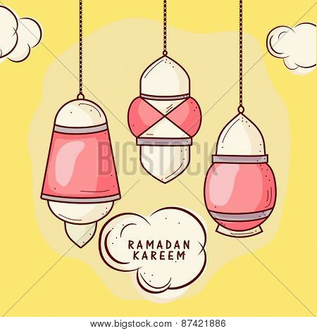 Colorful hanging lanterns on yellow cloudy sky, concept for Islamic holy month of prayers, Ramadan Kareem celebrations.