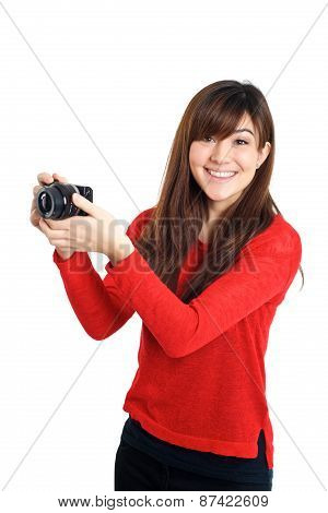 Asian Girl Taking Photo With A Compact Camera Looking At The Camera