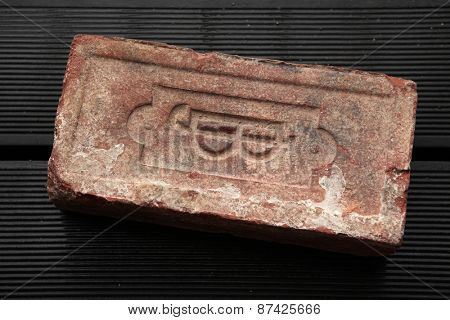 Monogram J.B. sealed on an old brick produced in the 19th century in the Austro-Hungarian Empire.