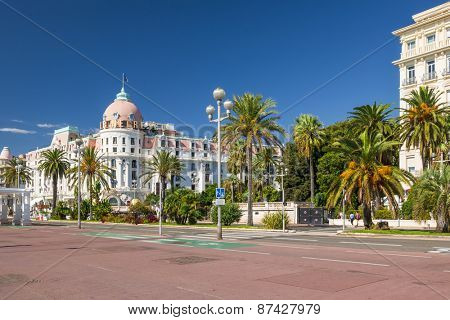NICE, FRANCE - OCTOBER 2, 2014: View of English promenade (Promenade des Anglais) with Hotel Negresco, one of the famous landmarks of the city.