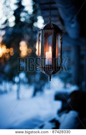 Porch decorated with lanterns and Christmas lights
