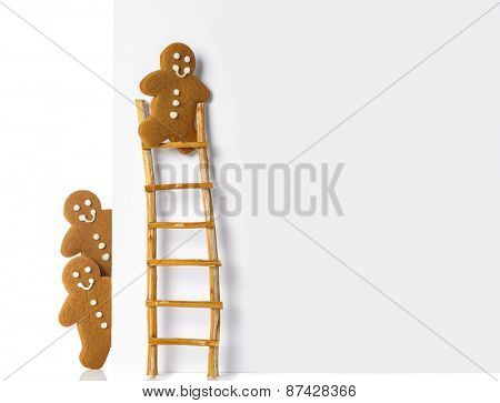 Gingerbread man up a ladder of advertising board