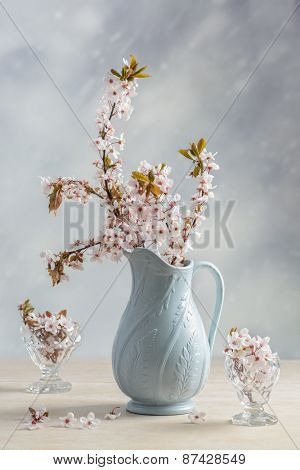 Antique pottery jug filled with blossom