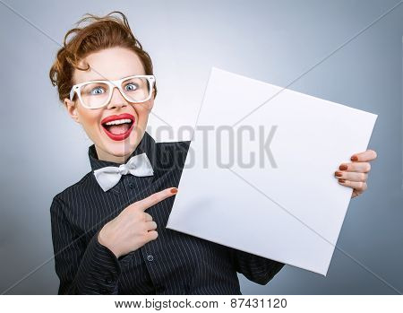 Surprised Woman With Blank White Board On Gray Isolated