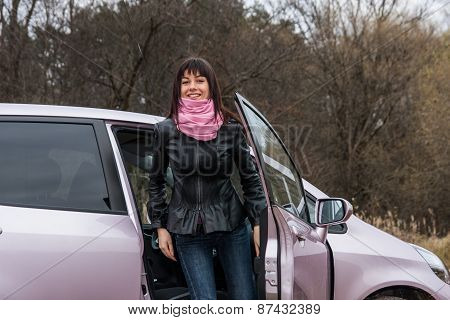 Girl get out from pink car