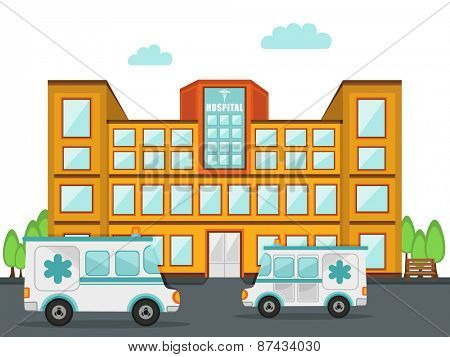 Front view of a big hospital building with two ambulance standing outside.