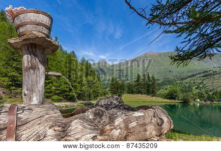 Natural spring water and small alpine lake in Piedmont, Northern Italy.
