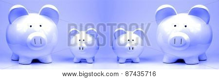 Two white piggy banks standing on backgrouind