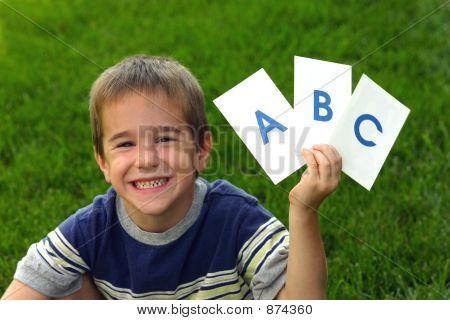 Boy Holding Abc'S