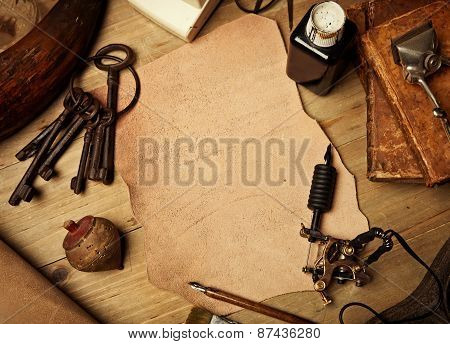 Set Of Vintage Elements With Piece Of Leather And Tattoo Machine