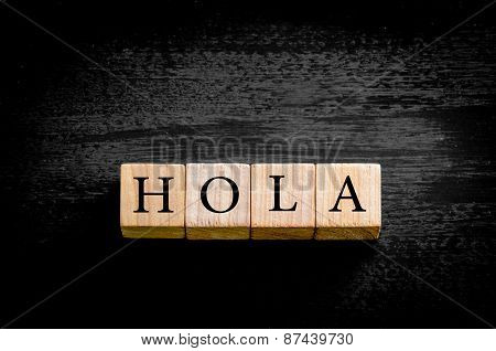 Word Hola Isolated On Black Background With Copy Space