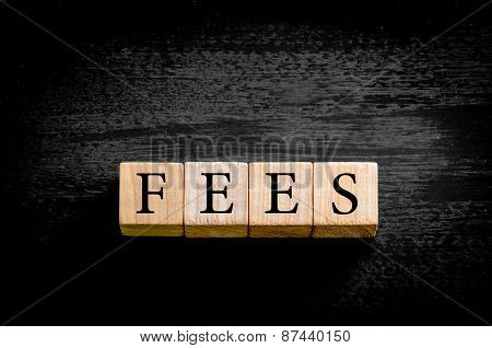 Word Fees Isolated On Black Background With Copy Space
