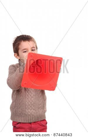 boy with orange traffic  cone
