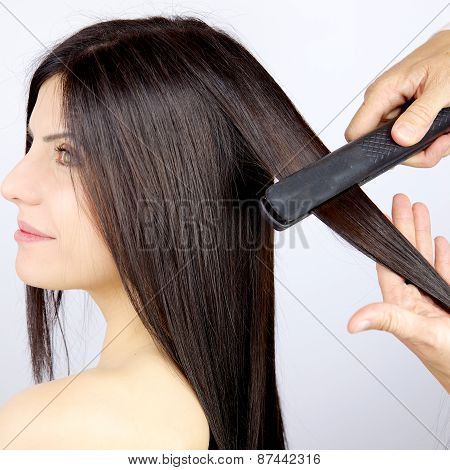 Beautiful Woman Getting Long Silky Hair Straightened By Hairstylist