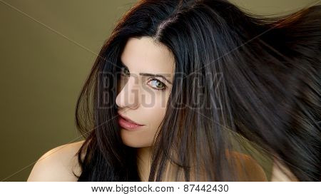 Beautiful Woman With Green Eyes Moving Long Hair