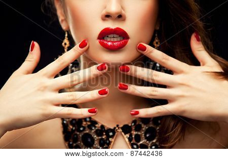 Red Sexy Lips and Nails closeup. Open Mouth. Manicure and Makeup. Make up concept