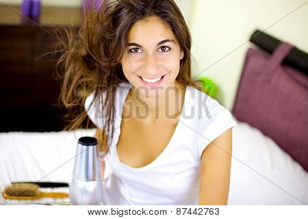 Cute Brunette Blow Drying Long Hair At Home In Bed Smiling Happy