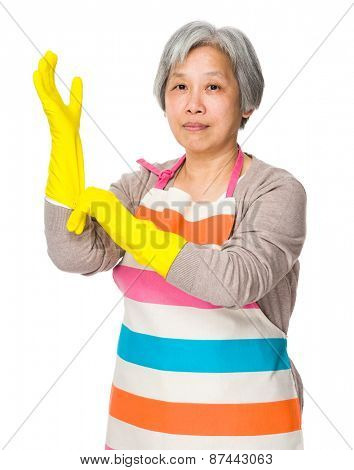 Old lady wear of plastic gloves for protection