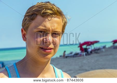 Displeased Boy At The Beach