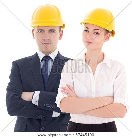 Young Man And Woman In Builder 's Helmets Isolated On White
