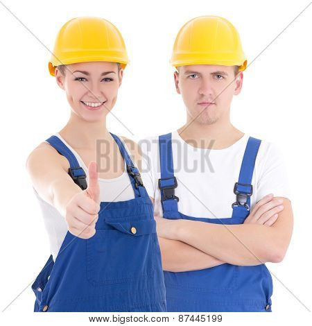 Young Man And Woman In Builder 's Uniform Isolated On White