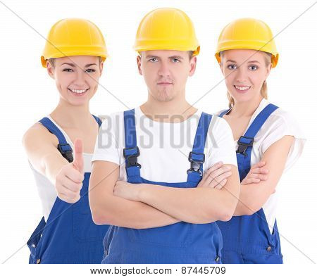 Two Young Women And Man In Blue Builder 's Uniform Isolated On White