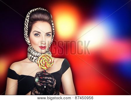Beautiful Woman In Retro Pin Up Style With Lollipop On The Bright Background