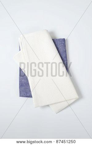 white and blue napkins on white background