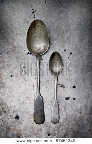 Vintage Tableware On A Metal Old Background.