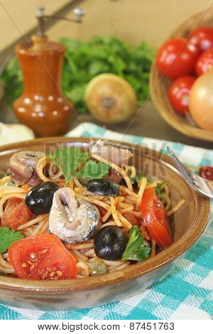 Spaghetti Alla Puttanesca With Anchovy And Tomatoes