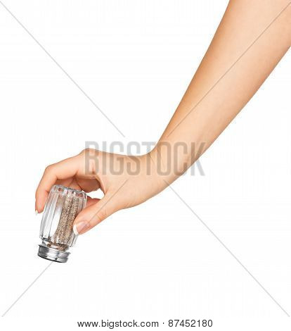 Hand Holding A Glass Pepper Isolated On White Background