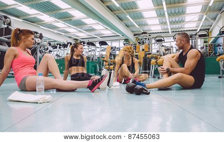 Friends talking on fitness center after training day