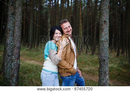 Happy Couple In A Pine Forest